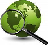 stock photo of usa map  - A magnifying glass takes a closer look at the earth - JPG