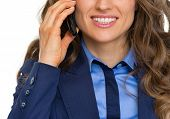Closeup On Happy Business Woman Talking Cell Phone