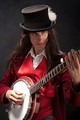 stock photo of banjo  - A misterious picture  of banjo player  - JPG