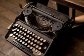 stock photo of qwerty  - old typewriter with Russian letters on a wooden background - JPG