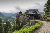 View Of Japanese Buddhist Temple In Yamadera With Beautiful Landscape In The Background