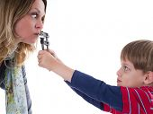 stock photo of disobedient  - Naughty child does not allow his nervous mother to talk  - JPG