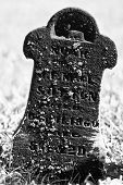 picture of headstones  - Small and Dark Headstone in a Cemetery for a Child - JPG