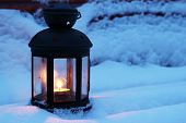 Candle Lamp On Snowy Bench