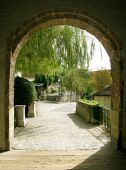 picture of cornerstone  - Arched cobblestone walkway leading out of a castle - JPG