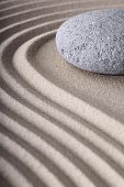 Japanese meditation spa garden pattern of sand and stones with curved lines for balance and relaxation zen buddhism