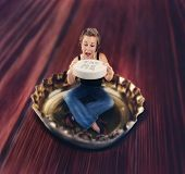 stock photo of eat me  - a miniature girl eating a giant pill while sitting in a bottle cap - JPG
