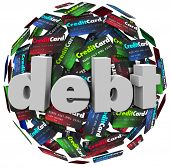 The word Debt in 3d letters on a ball or sphere of credit cards to illustrate being behind in bills