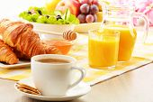 stock photo of croissant  - Breakfast with coffee orange juice croissant egg vegetables and fruits - JPG