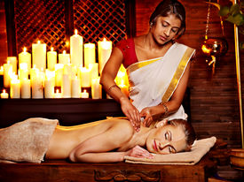 foto of panchakarma  - Young woman having oil Ayurveda spa treatment - JPG