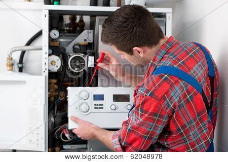 Technician Servicing Heating Boiler poster