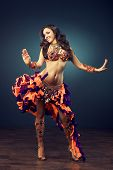 stock photo of belly-dance  - A dancing girl in the carnival costume. 