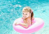 Smiling Little Girl In Swimming Pool