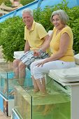 couple at fish spa skin treatment