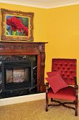 Fireplace and red chair, image on the wall is my own