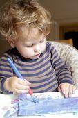 stock photo of finger-painting  - Toddler boy child drawing finger painting making art  - JPG