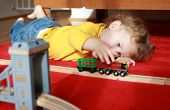 picture of track home  - Child toddler boy playing at home with trains and tracks - JPG