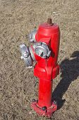 image of firehouse  - new red fire hydrant water pipe on street - JPG
