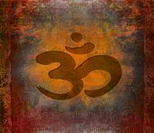 pic of east-indian  - om aum symbol on a grunge texture  - JPG