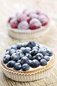 Closeup of fancy gourmet fresh berry dessert tarts
