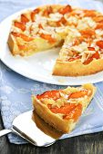 Slice of fresh baked apricot and almond pie dessert