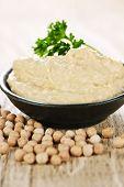 Bowl of fresh hummus with raw organic chickpeas
