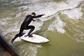 Surfer Surfs At The Isar In Huge Waves