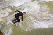 Surfer Surfs At The Isar In Huge Waves For Season Opening Event At The Wittelsbacher Bridge