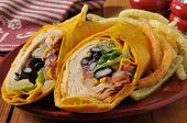 stock photo of chipotle  - A southwestern chipotle chicken wrap sandwich with veggie potato crisps - JPG
