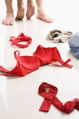 stock photo of intercourse  - Couple having intercourse with red underwear on floor I use red color so it can be used to support AIDS cause  - JPG