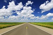 picture of long distance  - Long stretch of flat highway in Saskatchewan prairies - JPG