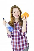 Smiling young woman holding cleaning supplies isolated on white