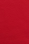 Red natural leather background or texture close up