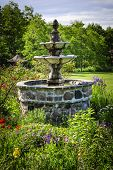 Lush green garden with tiered stone fountain