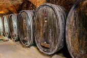 Old Wine Cellar With Barrels