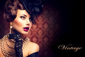 Retro Woman Portrait. Vintage Style Girl Wearing Old fashioned Hat and Gloves, retro Hairstyle and M
