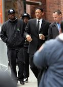 NYC - APRIL 15: Actor Will Smith, carrying a coffee cup,  on the set of Men In Black 3 (MIB3) currently being filmed in New York City on Friday, April 15, 2011.