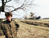 ODZAK, BOSNIA - MAR 24: A Bosnian Serb soldier talks while his house is blown up by United States Ar