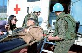 SARAJEVO, BOSNIA - APRIL 19: Red Cross workers and Ukrainian soldiers with the United Nations help a