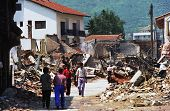 PEC, KOSOVO - JULY 3:Returning  refugees survey the destroyed downtown of Pec, Kosovo, on Saturday,