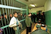 MOSCOW - SEPTEMBER 20: Moscow police process 50 Caucasian men and women, arrested earlier as part of a sweep to catch those responsible for a string of deadly bombings which killed 300 Russians on September 20, 1999 in Moscow