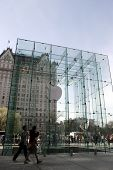 NEW YORK - APR 4: Pedestrians walk in front of the cube of glass over the top of the Apple computer