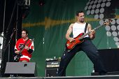 BUDAPEST, HUNGARY - AUGUST 5: The Bloodhound Gang performs at the annual Sziget music festival on August 5, 2004 in Budapest. From left, guitarist Lupus and bassist Evil Jared.
