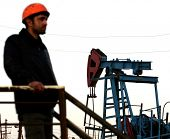 BAKU - AZERBAIJAN - JAN. 31: A roughneck maintains a nodding donkey at a producing oil field near Baku, Azerbaijan, on Saturday, January 31, 2009.