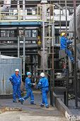 BUCHAREST, ROMANIA - NOV 9: Oil workers perform maintenance duties at the Arpechim refinery near Pit