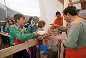 KUKES, ALBANIA, 18 APRIL 1999 - Italian aid workers feed  Kosovar Albanian refugees at a camp in nor