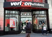 NEW YORK CITY - APRIL 19: People walk past a Verizon Wireless retail outlet in New York City, on Fri