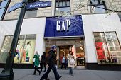 NEW YORK CITY - APRIL 19: Shoppers walk past a Gap retail outlet in New York City, on Friday, April