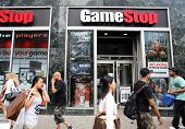 NEW YORK CITY - JULY 8: Shoppers walk past a GameStop retail store in New York City, New York, on Mo