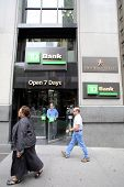 NEW YORK CITY - JULY 11: Pedestrians walk past a TD (Toronto Dominion) bank retail branch in lower M